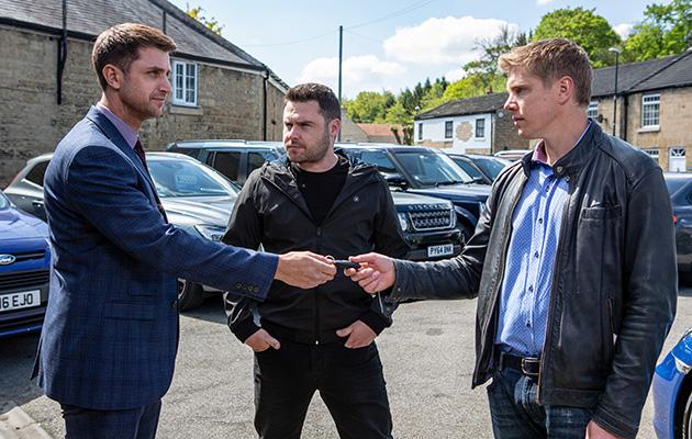 Robert and Aaron visit a car dealership in Emmerdale