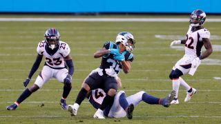 Rodney Smith #35 of the Carolina Panthers is tackled by Josey Jewell #47 of the Denver Broncos during the third quarter of their game at Bank of America Stadium on Dec. 13, 2020 in Charlotte, North Carolina.