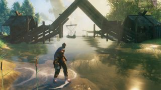 Valheim in-game screenshot of a steep bridge and boats in the water