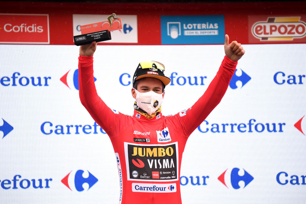 LAGOS DE COVADONGA SPAIN SEPTEMBER 01 Primoz Roglic of Slovenia and Team Jumbo Visma celebrates winning the Red Leader Jersey on the podium ceremony after the 76th Tour of Spain 2021 Stage 17 a 1855km stage from Unquera to Lagos de Covadonga 1085m lavuelta LaVuelta21 on September 01 2021 in Lagos de Covadonga Spain Photo by Tim de WaeleGetty Images