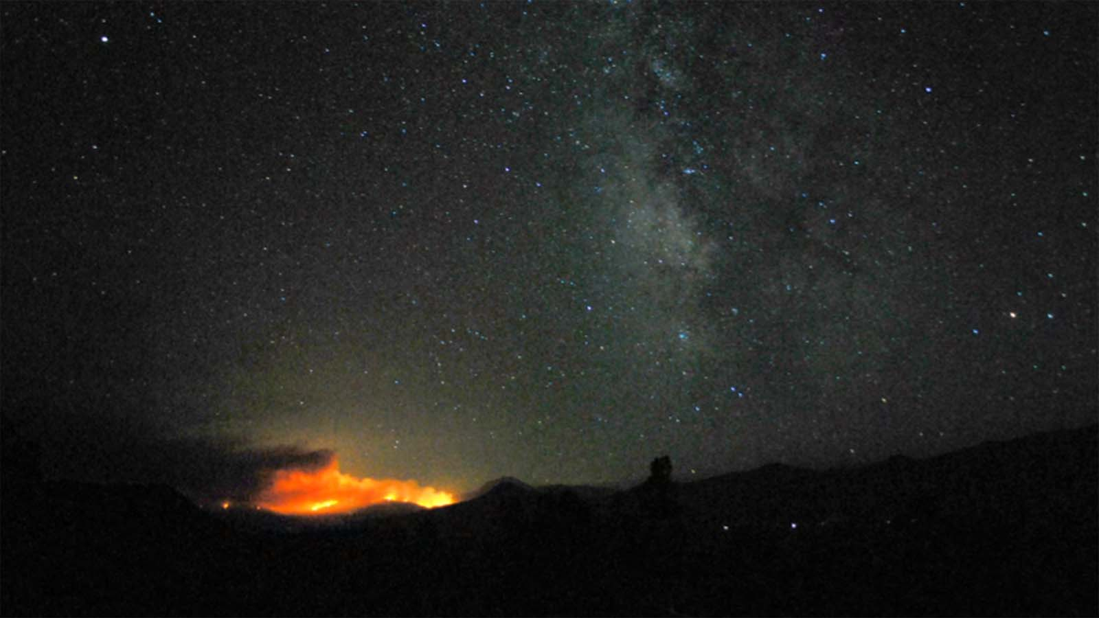 The Dixie Fire On The Horizon Beneath The Milky Way And A Starry Sky