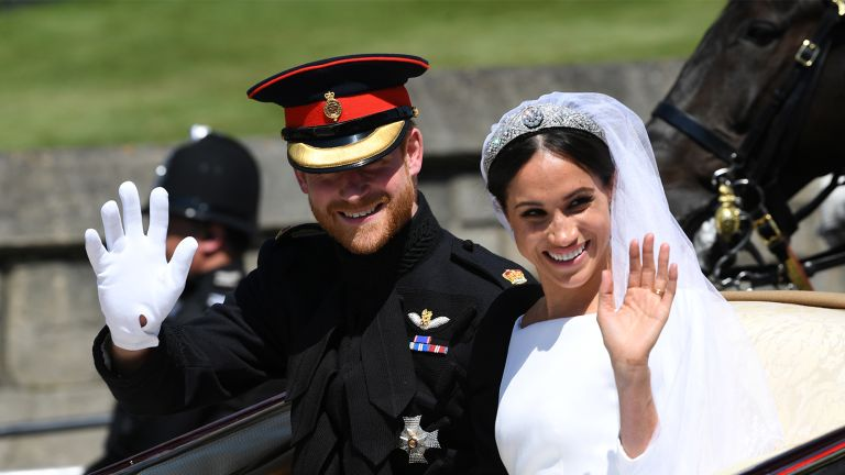 WINDSOR, ENGLAND - MAY 19: Prince Harry, Duke of Sussex and Meghan, Duchess of Sussex wave from the Ascot Landau Carriage during their carriage procession on Castle Hill outside Windsor Castle on May 19, 2018 in Windsor, England. (Photo by Paul Ellis - WPA Pool/Getty Images)