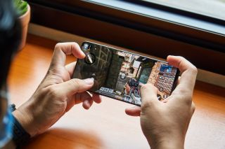 Playing free-to-play shooter video game Call of Duty: Mobile games on the Samsung Galaxy S21 Ultra flagship smartphone.