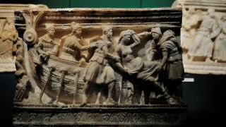 An Etruscan funerary urn showing the abduction of Helen by Paris, the mythical event said to have caused the advent of the Trojan War.