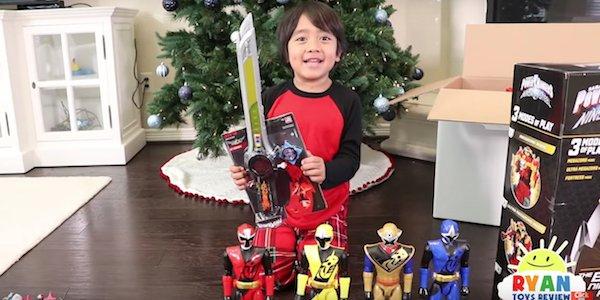 Ryan opening Power Rangers toys