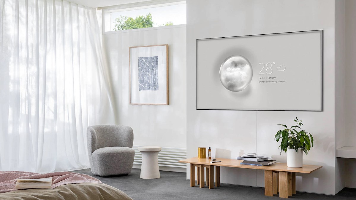 A living room featuring a wall-mounted LG Nano 90