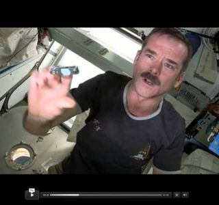Chris Hadfield cutting fingernails