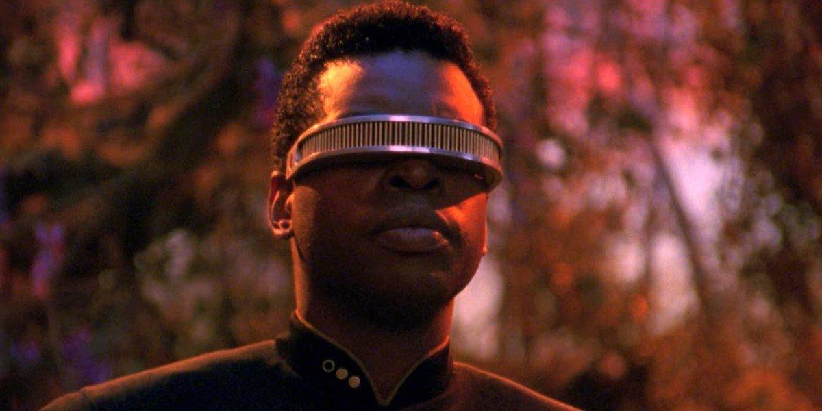 Geordi La Forge staring in a forest Star Trek: The Next Generation