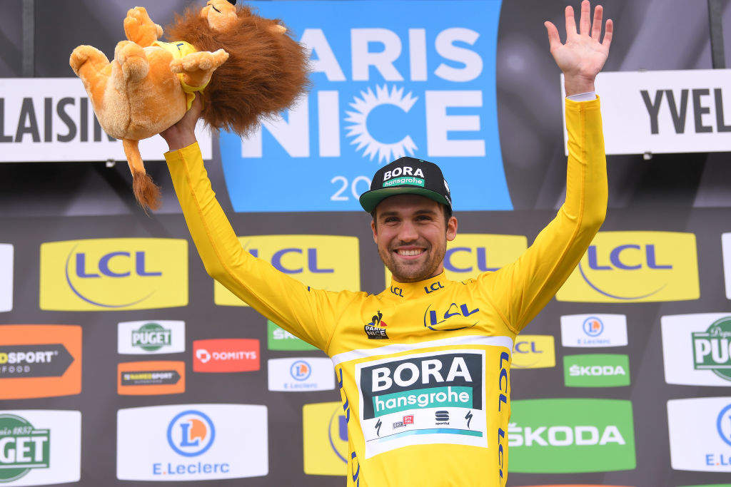 Max Schachmann pulls on the leader's yellow jersey at Paris-Nice