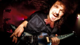 Pantera guitarist Dimebag Darrell performs live