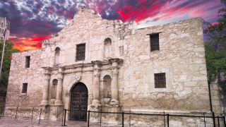 Archaeologists have found three graves containing human remains inside the historic Alamo Mission building in central San Antonio, Texas.
