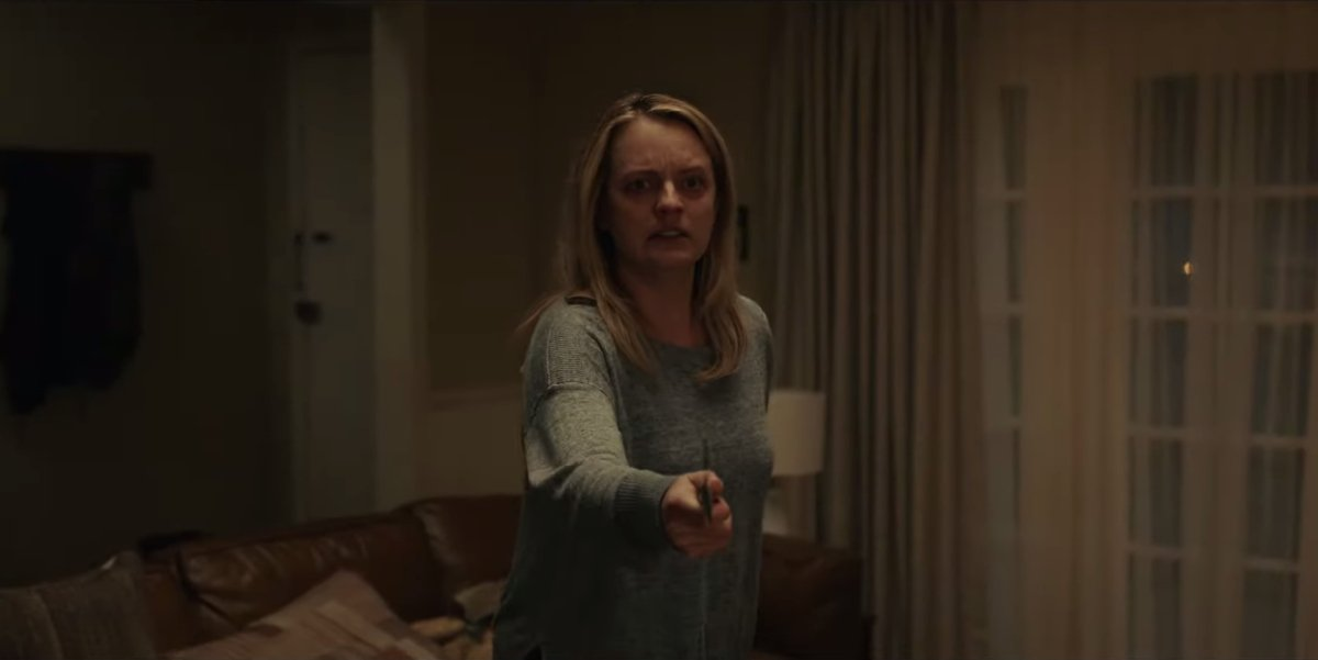 The Invisible Man Elizabeth Moss holding a knife