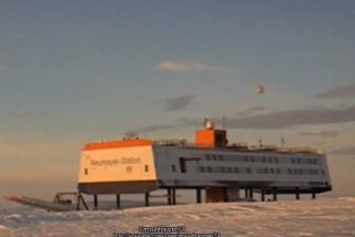 Blurry object claimed to be a UFO floating above an Antarctic research station.