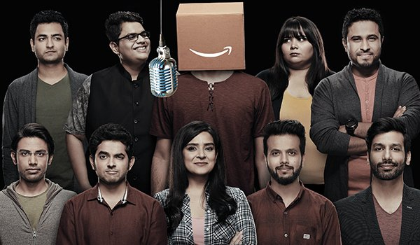 Comicstaan comedians lined up, with an unknown comic wearing an Amazon box