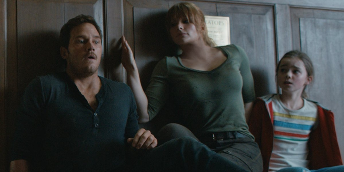 Jurassic World: Fallen Kingdom Owen, Claire, and Maisie hiding from the Indoraptor