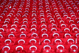Turkeish flags on seats at a football match