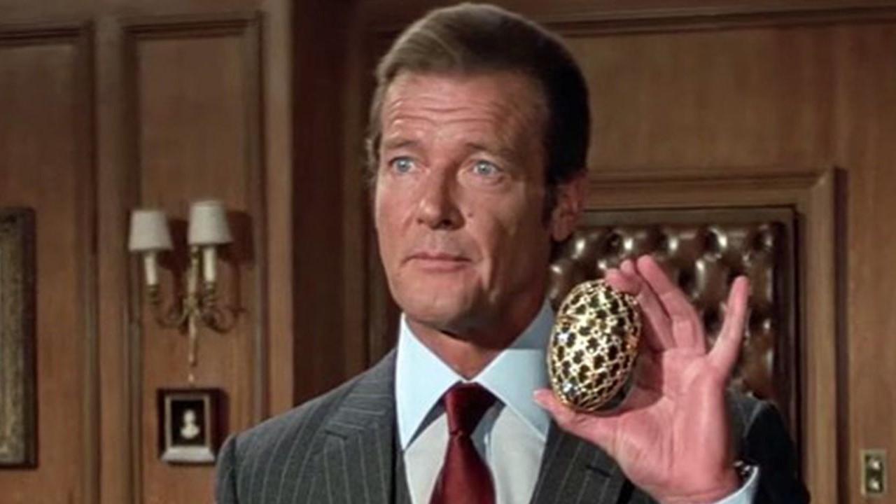 Roger Moore as James Bond.
