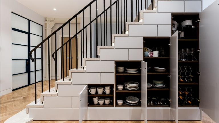 16 under stair storage solutions real homes. Black Bedroom Furniture Sets. Home Design Ideas