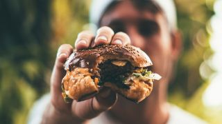 person holding hamburger