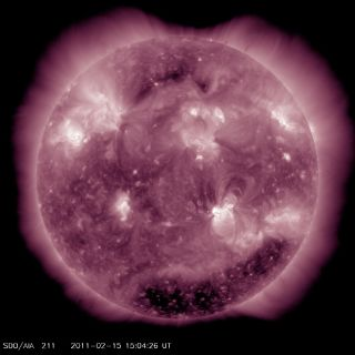 An X2.2 flare erupted from the sun's active region 1158 (at lower right) at about 0150 UT or 8:50 pm ET on Feb. 14, 2011.