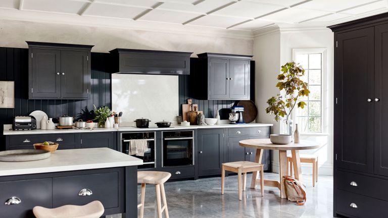 black kitchen with island and white backsplash
