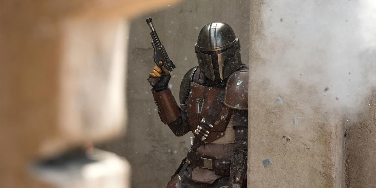 The Mandalorian raising his gun
