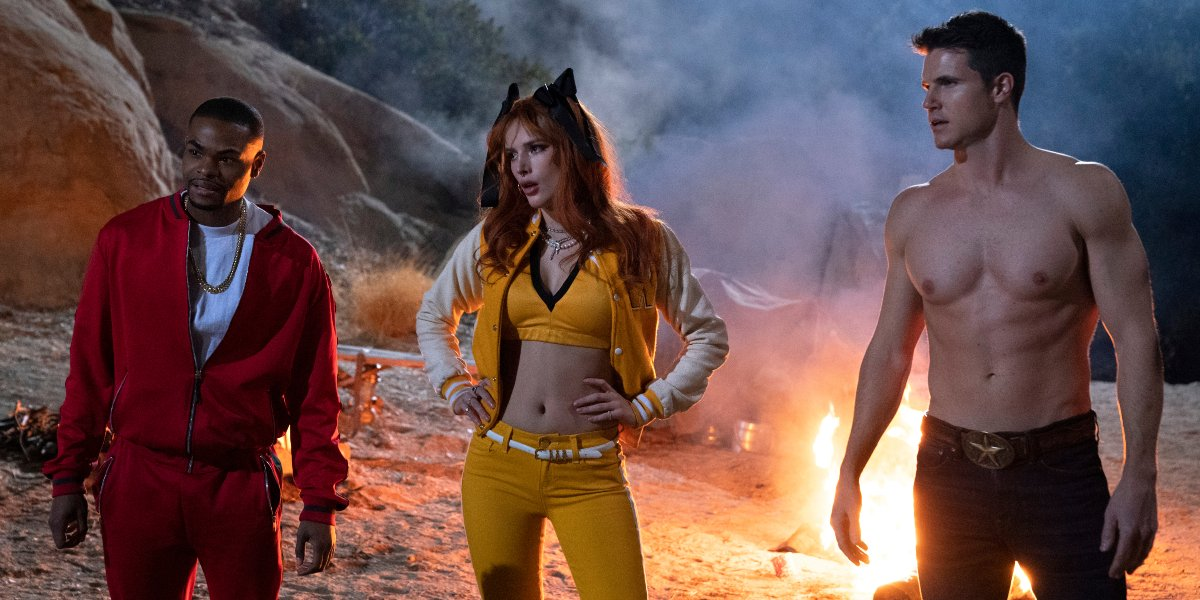 The Babysitter: Killer Queen Andrew Bachelor, Bella Thorne, and Robbie Amell standing in front of a fire