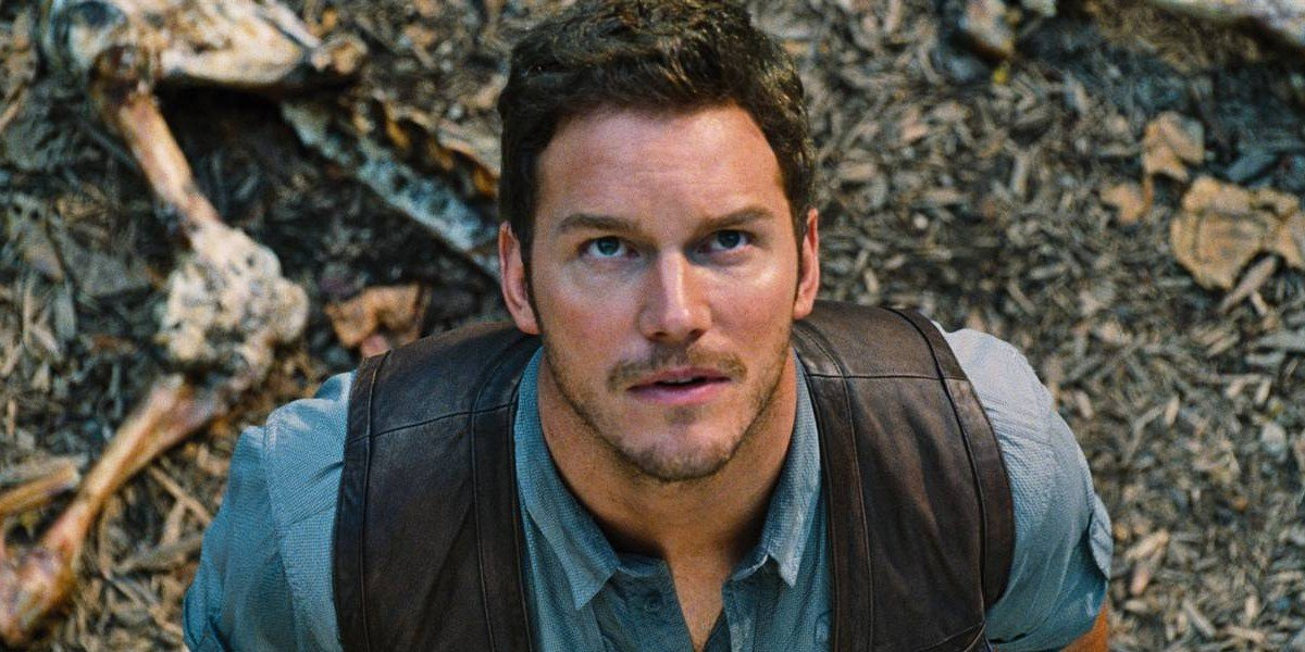 Owen Grady stands looks above in a scene from 'Jurassic World'