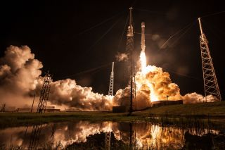 A SpaceX Falcon 9 rocket launches the Telstar 19V satellite in July of 2018. This rocket's first stage is scheduled to help loft the Es'hail-2 satellite on Nov. 15, 2018.