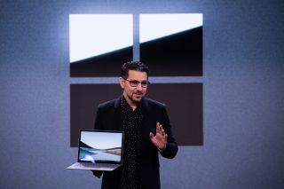 Panos Panay holding a Microsoft Surface Laptop 3.