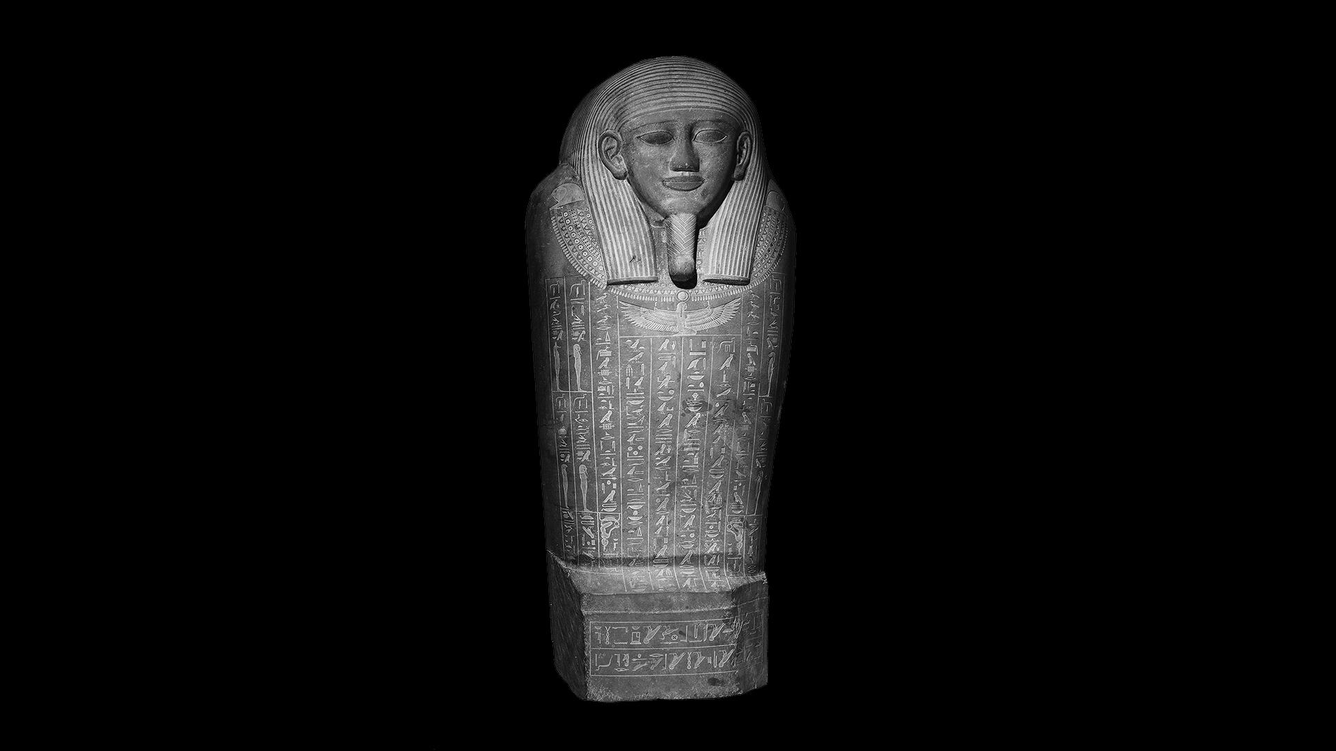 The lid of Psamtik's sarcophagus is carved from a single slab of stone covered with engravings of protective spells.