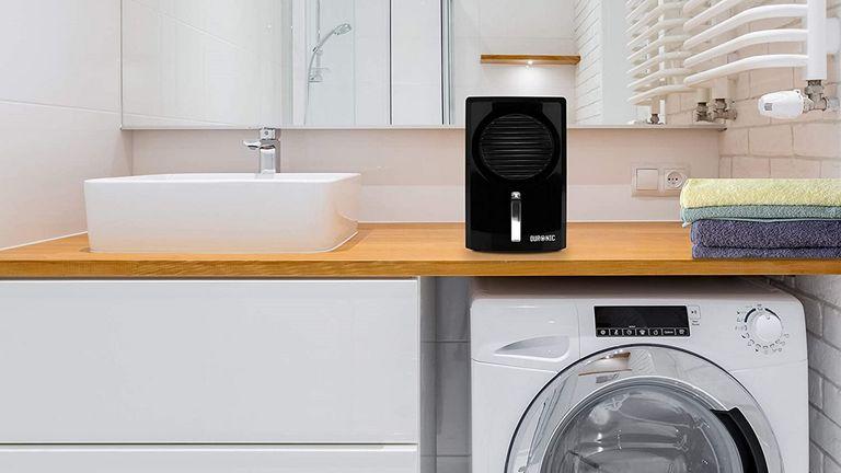 best dehumidifier: Duronic DH05 Mini Dehumidifier in utility room