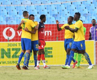 Mothobi Mvala celebrates his goal with teammates