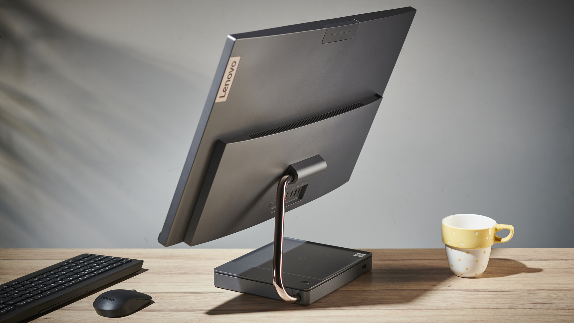 Lenovo IdeaCentre AIO 5 all-in-one PC on a desk in an office