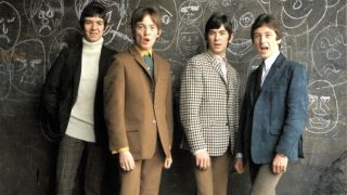 The Small Faces standing in front of a chalkboard