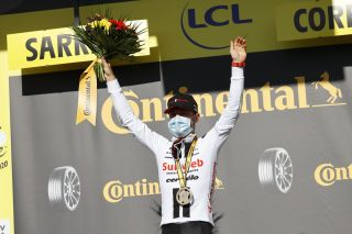 Sunweb's Marc Hirschi takes the applause after winning stage 12 of the 2020 Tour de France