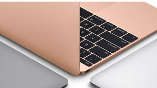 A rose gold Apple Macbook