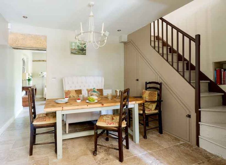 Shaker style kitchen in a cottage with round island