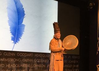 Rev. Nick Miles, of the Pamunkey Tribe, opens the 2014 MU69/Arrokoth naming ceremony at NASA Headquarters with a traditional Algonquian song.