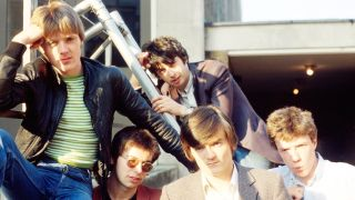 The Undertones sitting on the concrete roof of a building