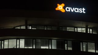 Avast logo on a building at night.