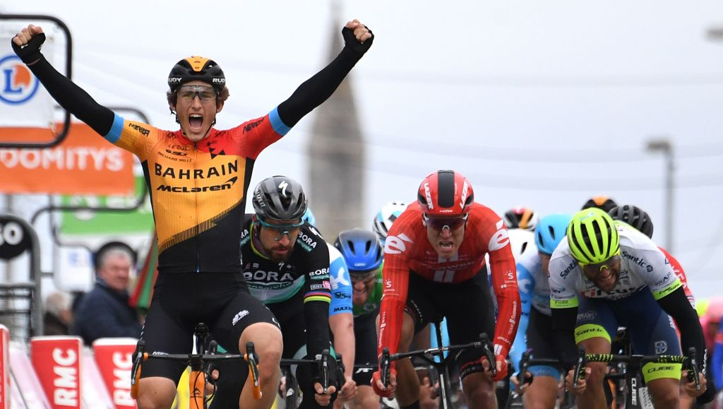 Bahrain McLaren Spanish rider Ivan Garcia Cortina L celebrates as he crosses the finish line at the end of the 2125 km 3rd stage of the 78th Paris Nice cycling race stage between ChalettesurLoing and La Chatre on March 10 2020 Photo by Alain JOCARD AFP Photo by ALAIN JOCARDAFP via Getty Images