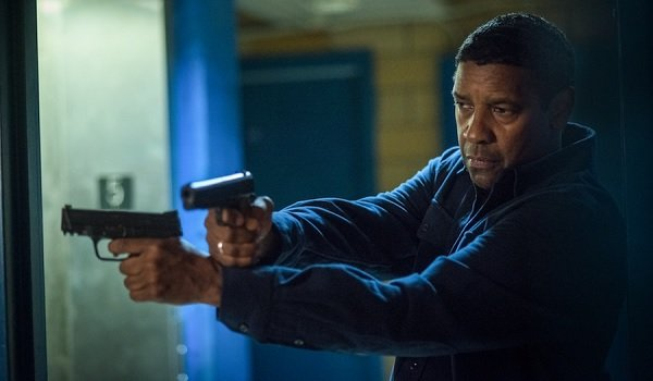 The Equalizer 2 Denzel Washington moves around a corner with guns drawn