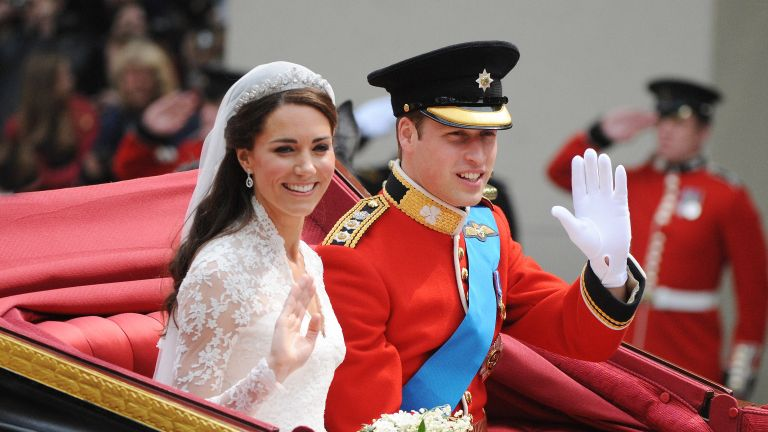Prince William, Duke of Cambridge and Catherine, Duchess of Cambridge depart Westminster Abbey after there marriage on April 29, 2011 in London, England