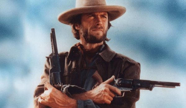 The Outlaw Josey Wales Clint Eastwood Josey rides with two guns
