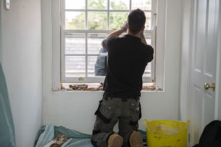 a worker repairing sash windows