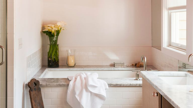 Small bathroom with pink tiles
