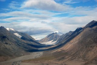 The landscape of Quttinirpaaq National Park is dominated by glaciers and sparse high-arctic tundra vegetation.
