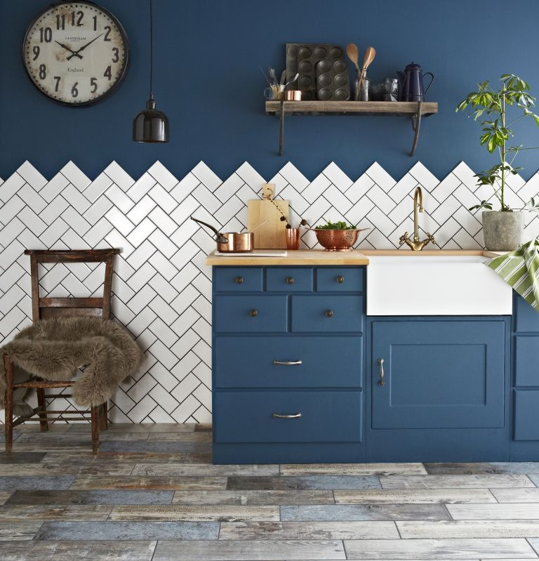 best kitchen cupboard paint: blue painted kitchen with white tiles