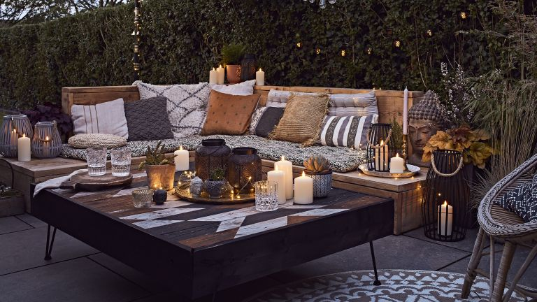 outdoor seating area with garden lighting and lanterns